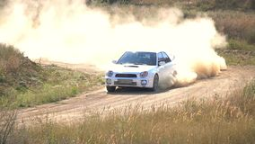 Rally Car Driving on a Dusty Road. Slow Motion stock video