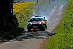 Rally car on fire. Rally car in flames in the Jim Clark Rally Stock Photos