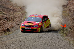 Rally car on fire Royalty Free Stock Photography
