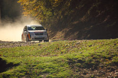 Rally Car on gravel. Santa, Sibiu, Romania - October 20, 2012:  Santa Rally Show in the middle of nature, somewhere in Carpathian Mountains, near Paltinis Royalty Free Stock Photos