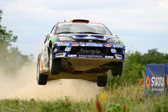Rally car jumping. Hungarian rally champion Balazs Benik jumping at Szombathely rally Royalty Free Stock Photos