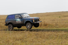 Rally car jumping over the road Stock Photography