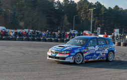 Rally car in move with crowd watching Royalty Free Stock Images