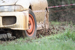Rally car in muddy road Royalty Free Stock Photo