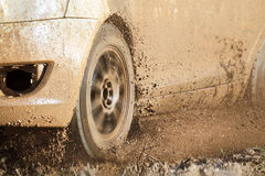 Rally car in muddy road Stock Image