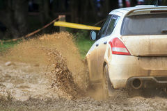 Rally car in muddy road Stock Photo