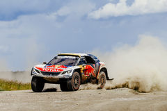 Rally car Peugeot driving on a dust road Royalty Free Stock Photo