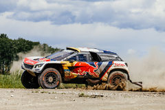 Rally car Peugeot turn dust road Stock Images