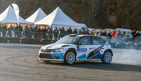 Rally car during race with crowd watching Royalty Free Stock Image