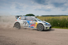 Rally car race in 71st Rally Poland. MIKOLAJKI, POLAND - JUN 28: Jari-Matti LATVALA and his codriver Miikka ANTTILA in a Volkswagen Polo R WRC race in the 71st stock photography