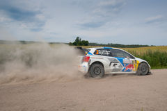 Rally car race in 71st Rally Poland. MIKOLAJKI, POLAND - JUN 28: Jari-Matti LATVALA and his codriver Miikka ANTTILA in a Volkswagen Polo R WRC race in the 71st royalty free stock images
