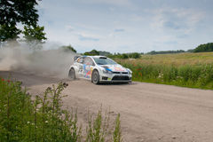 Rally car race in 71st Rally Poland. MIKOLAJKI, POLAND - JUN 28: Jari-Matti LATVALA and his codriver Miikka ANTTILA in a Volkswagen Polo R WRC race in the 71st royalty free stock photo