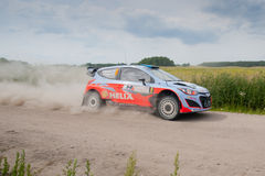 Rally car race in 71st Rally Poland. MIKOLAJKI, POLAND - JUN 28: Juho HANNINEN and his codriver Tomi TUOMINEN in a Hyundai i20 WRC race in the 71st Rally Poland royalty free stock images