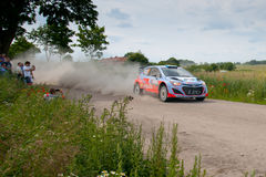 Rally car race in 71st Rally Poland. MIKOLAJKI, POLAND - JUN 28: Juho HANNINEN and his codriver Tomi TUOMINEN in a Hyundai i20 WRC race in the 71st Rally Poland Royalty Free Stock Image
