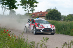 Rally car race in 71st Rally Poland. MIKOLAJKI, POLAND - JUN 28: Martin KANGUR and his codriver Kuldar SIKK in a Ford Fiesta S2000 race in the 71st Rally Poland stock image