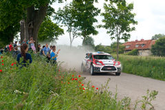 Rally car race in 71st Rally Poland. MIKOLAJKI, POLAND - JUN 28: Martin KANGUR and his codriver Kuldar SIKK in a Ford Fiesta S2000 race in the 71st Rally Poland royalty free stock image