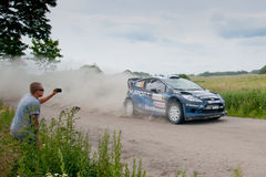 Rally car race in 71st Rally Poland. MIKOLAJKI, POLAND - JUN 28: Mikko HIRVONEN and his codriver Jarmo LEHTINEN in a Ford Fiesta RS WRC race in the 71st Rally stock photography