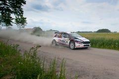 Rally car race in 71st Rally Poland. MIKOLAJKI, POLAND - JUN 28: Ott TANAK and his codriver Raigo MOLDER in a Ford Fiesta R5 race in the 71st Rally Poland, on Stock Photography