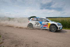 Rally car race in 71st Rally Poland. MIKOLAJKI, POLAND - JUN 28: Sebastien OGIER and his codriver Julien INGRASSIA in a Volkswagen Polo R WRC race in the 71st royalty free stock photography