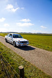 Rally car racing in beautiful Dutch landscape Royalty Free Stock Images