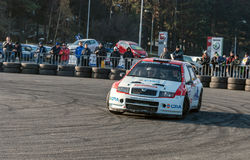 Rally car racing with crowd watching in the back Royalty Free Stock Image