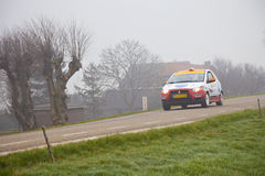 Rally car racing in the fog Stock Photo