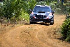 Rally car racing on track Stock Photos