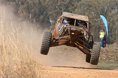 Rally car ramping. In an offroad rally stock photos