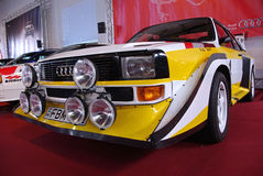 Rally car on red stage Stock Photography