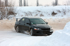 Rally car on snowy road Stock Image