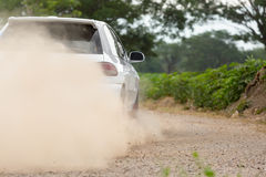 Rally Car speed in dirt road Royalty Free Stock Photos