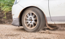 Rally Car speed in dirt track. White rally Car speed in dirt track Stock Photography