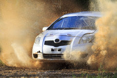 Rally car splashing the water Stock Image