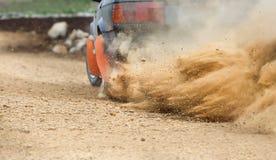 Rally Car turning in dirt track. Dust splashing from Rally Car turning in dirt track Royalty Free Stock Image