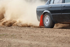 Rally Car turning in dirt track Stock Images