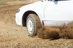Rally car turning in track Stock Photography