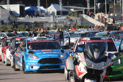 Rally Cars are Lined up behind police motorcycle in Monaco Stock Photography
