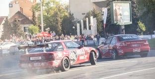 Rally cars during urban race Stock Photos