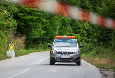 Rally championship and security car on the road Royalty Free Stock Photo