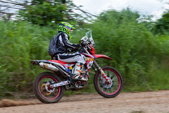 RALLY. CHIANG MAI, THAILAND - OCT 2: Unknown Motorcycle driver piloting his Motocross on the tracks, Oct 2, 2016 in Chiang Mai, Thailand Royalty Free Stock Photo