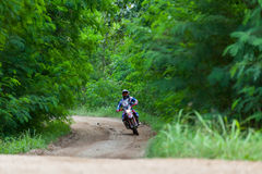 RALLY. CHIANG MAI, THAILAND - OCT 2: Unknown Motorcycle driver piloting his Motocross on the tracks, Oct 2, 2016 in Chiang Mai, Thailand Royalty Free Stock Photos