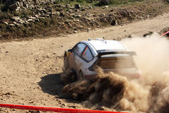 Rally competition. Close view of a rally car on a dirt road competition Stock Images