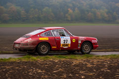 Rally. FLEINHEIM, GERMANY – OCTOBER 5, 2013: Wolfgang Pfeiffer and Richard Lüke driving their Porsche 911T at the ADAC Rallye Baden-Württemberg on October 5 Stock Photography