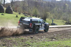 Rally Hummer. Dakar Series Central Europe Rally, Hummer driving very fast while stones and gravel fly around Royalty Free Stock Images
