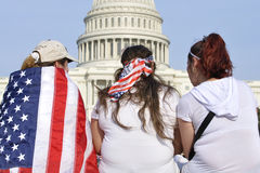 Rally for immigration reform. Washington D.C. - April 10, 2013: Demonstrators show their American patriotism by wearing the nation's flag in front of the capitol Stock Photo
