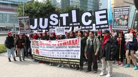 Rally for Justice for Erwiana in Hong Kong. Over Two Thousands of foreign domestic workers and supporters of the Indonesian maid at the heart of torture stock footage