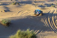 Rally off-road car 4x4 adventure driving safari on sand dunes on. The desert Royalty Free Stock Photography
