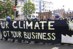 RALLY OUR CLIMATE IS NOT YOUR BUSINESS Stock Photos