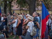 Rally of people in eve of 50th anniversary of the Warsaw Pact in. PRAGUE - AUGUST 21, 2018: Assembly of people commemorate on park Kampa the 50th anniversary of royalty free stock photos