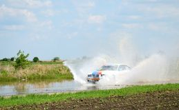 Rally race in Kunmadaras, Hungary. BMW driving over the large puddle. Stock Image